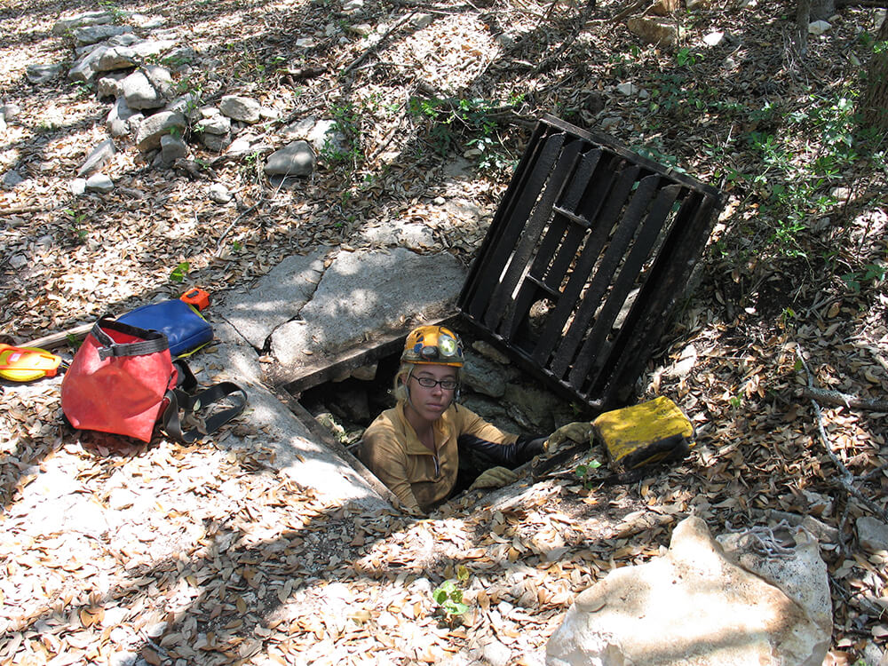 A volunteer helping to keep caves clean from sewer waste.