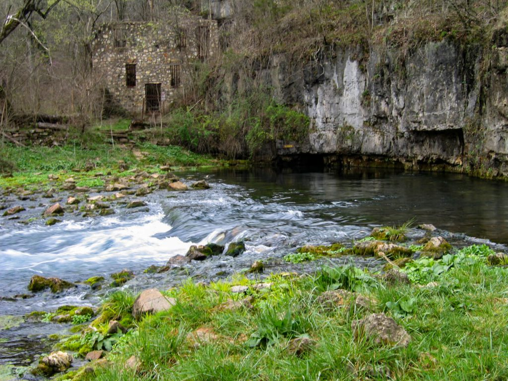 Beautiful cave springs and a stream of water.