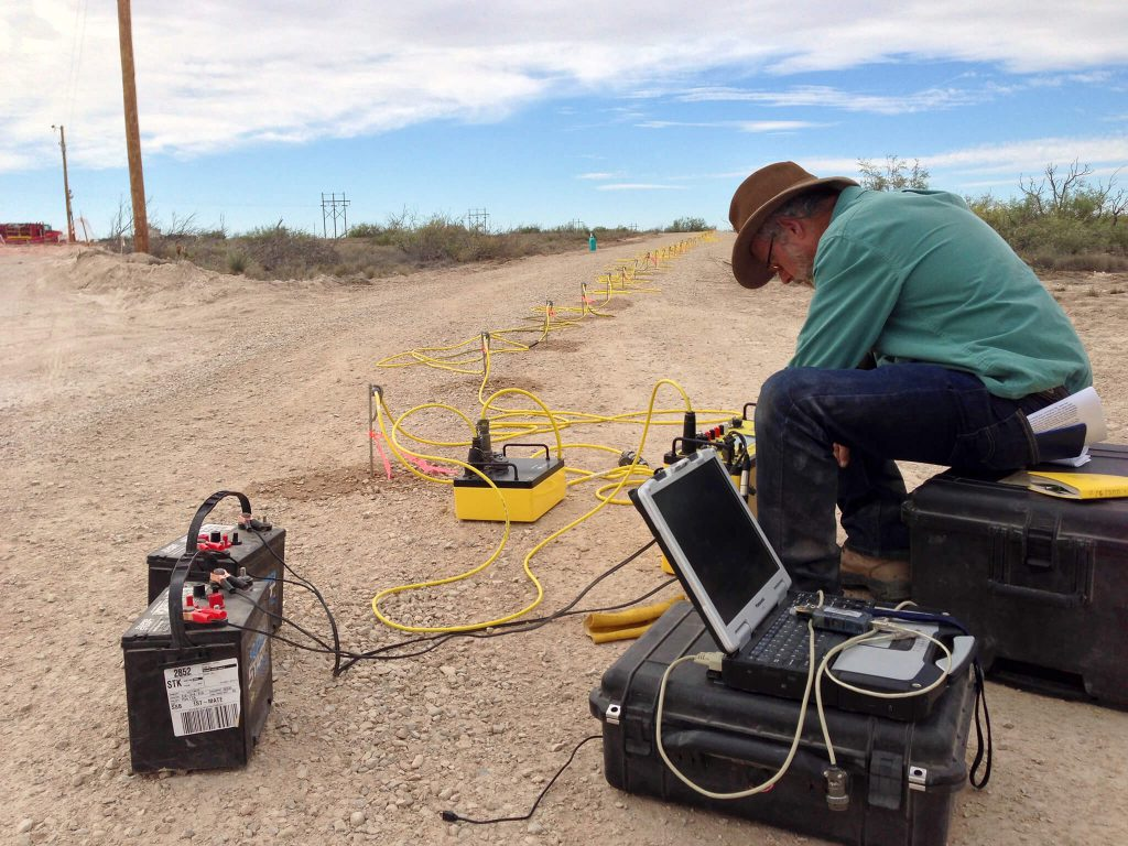 Dr. Lewis Land processing geophysical data from a cave sinkhole for land research.