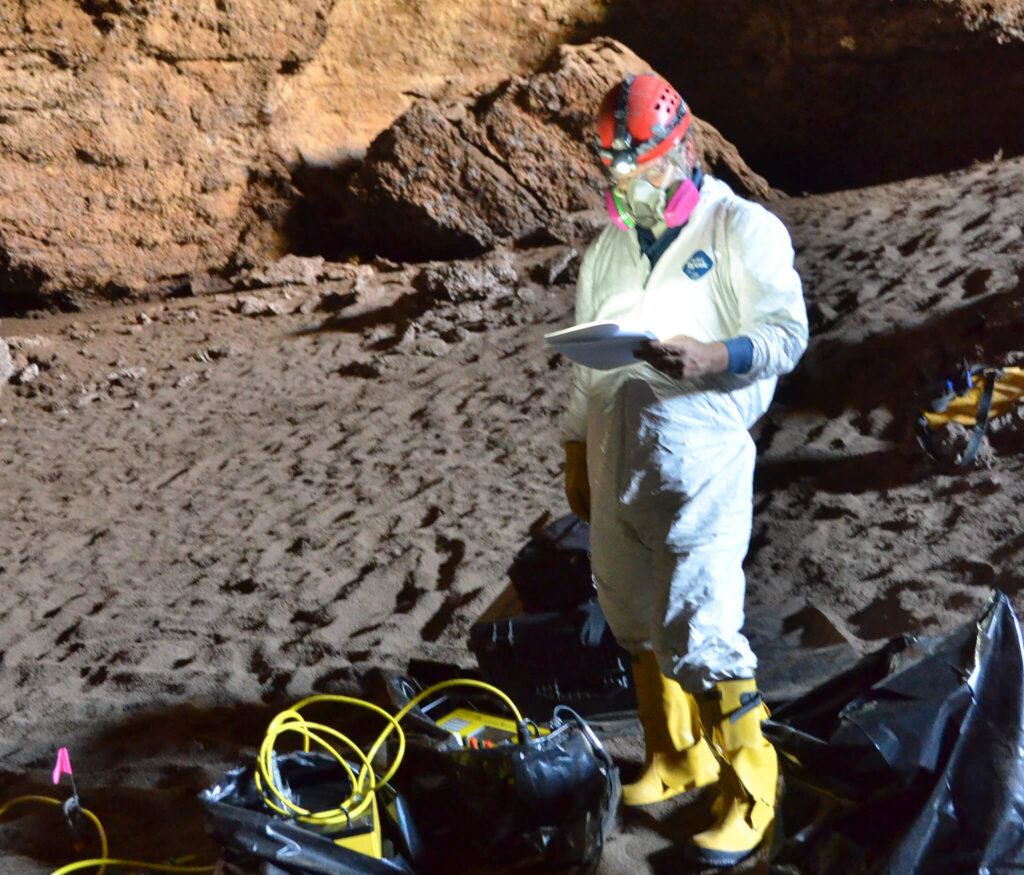 Dr. George Veni studying and protecting cave and karst areas.
