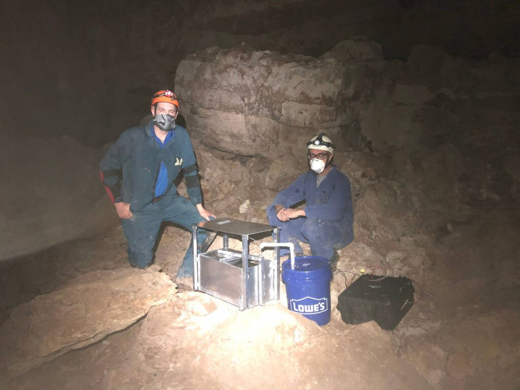 NCKRI crew members building a pan evaporimeter to record continuos data that estimates evaporation rates in high humidity caves like this one.